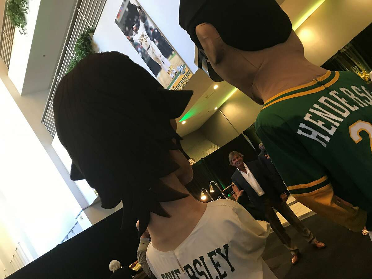 """Dennis Eckersley, middle, sizes up the Dennis Eckersley """"Big Head"""" before Wednesday's event for the A's Hall of Fame."""