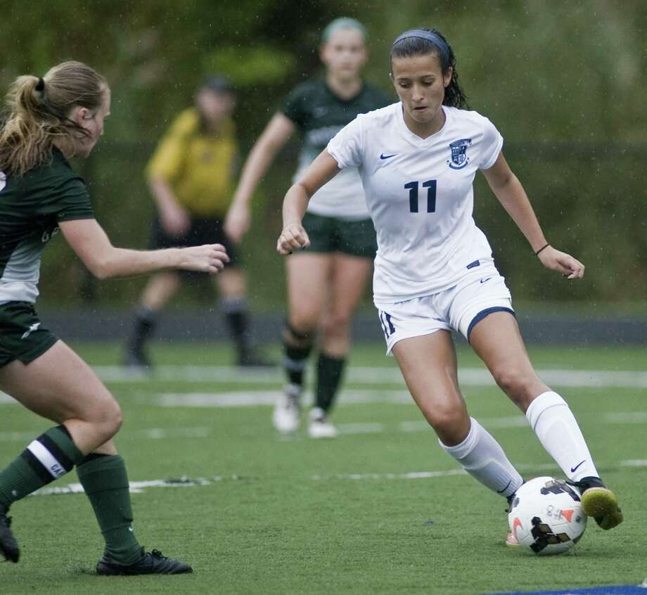 Immaculate High School's Kayla Mingachos controls the ball in a game against New Milford High School, played at Immaculate. Tuesday, Sept. 19, 2017 Photo: Scott Mullin / For Hearst Connecticut Media / The News-Times Freelance