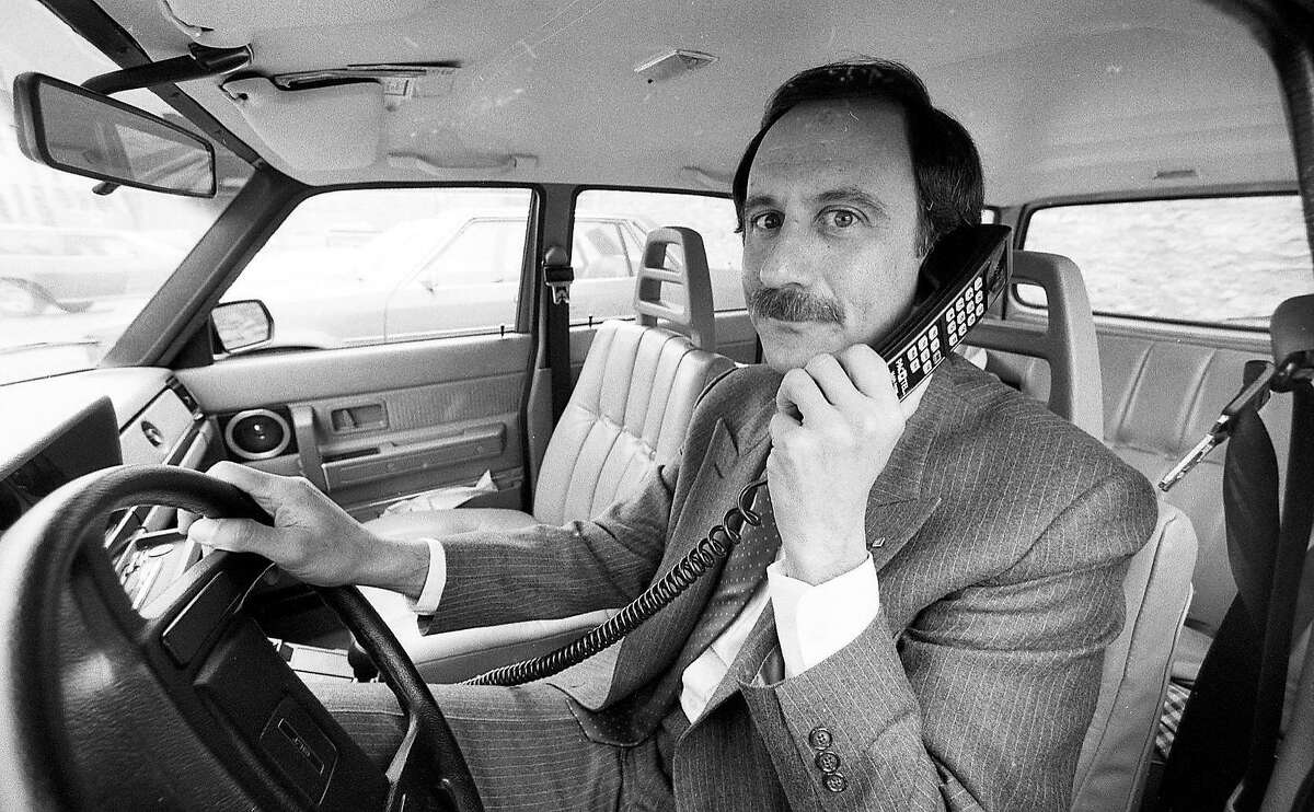 Nov. 14, 1984: Al Feinman with PacTel Mobile Services displays a new cellular phone. The cellular network was turned on in the Bay Area in 1985.