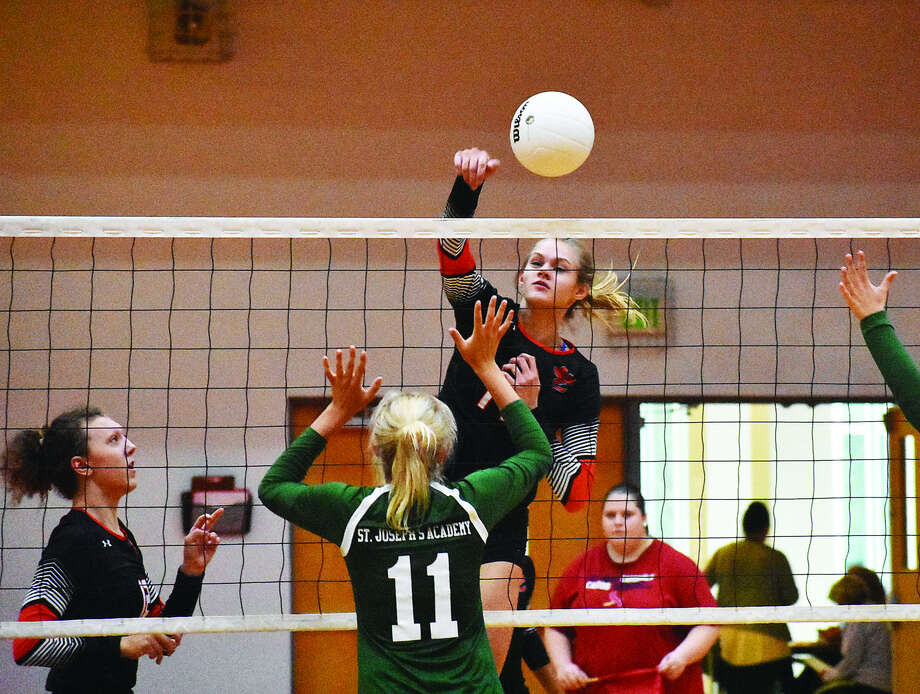 Edwardsville hitter Storm Suhre slams down one of her team-high 11 kills during the first game against St. Joseph's Academy on Wednesday inside Lucco-Jackson Gymnasium. Photo: Matthew Kamp