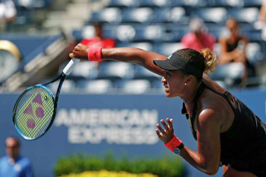 Naomi Osaka, of Japan, serves to Lesia Tsurenko, of Ukraine, during the quarterfinals of the U.S. Open tennis tournament, Wednesday, Sept. 5, 2018, in New York. (AP Photo/Jason DeCrow) Photo: Jason DeCrow / Copyright 2018 The Associated Press. All rights reserved