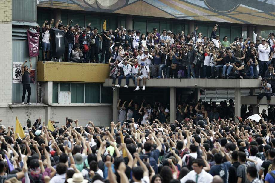 "Thousands of students at Mexico's National Autonomous University protest to demand an end to violence by groups of thugs known as ""porros,"" who are often registered but don't attend classes, at the University's main campus in Mexico City, Wednesday, Sept. 5, 2018. Students at Mexico's largest university have gone on strike after a campus attack against protestors on Monday, in which two students were seriously injured. (AP Photo/Rebecca Blackwell) Photo: Rebecca Blackwell /Associated Press / Copyright 2018 The Associated Press. All rights reserved."