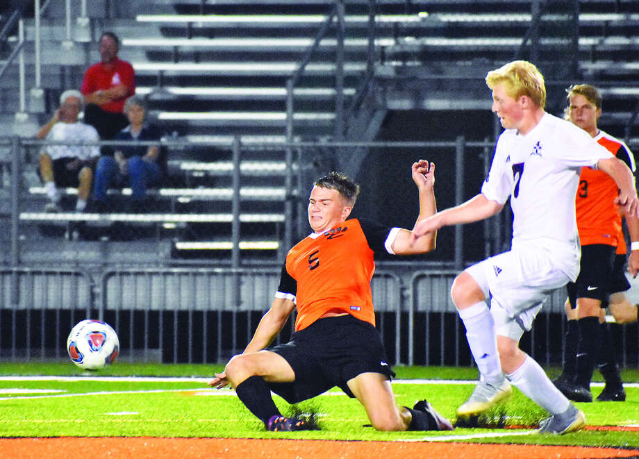 Edwardsville midfielder Bryce Broshow tackles the ball away from a Gibault player during the second half. Photo: Matthew Kamp