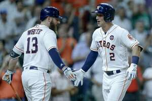 Houston Astros shortstop Alex Bregman (2) celebrates with first baseman Tyler White (13) after hitting a two-run home run during the third inning as the Houston Astros take on the Minnesota Twins at Minute Maid Park Wednesday Sept. 5, 2018 in Houston.