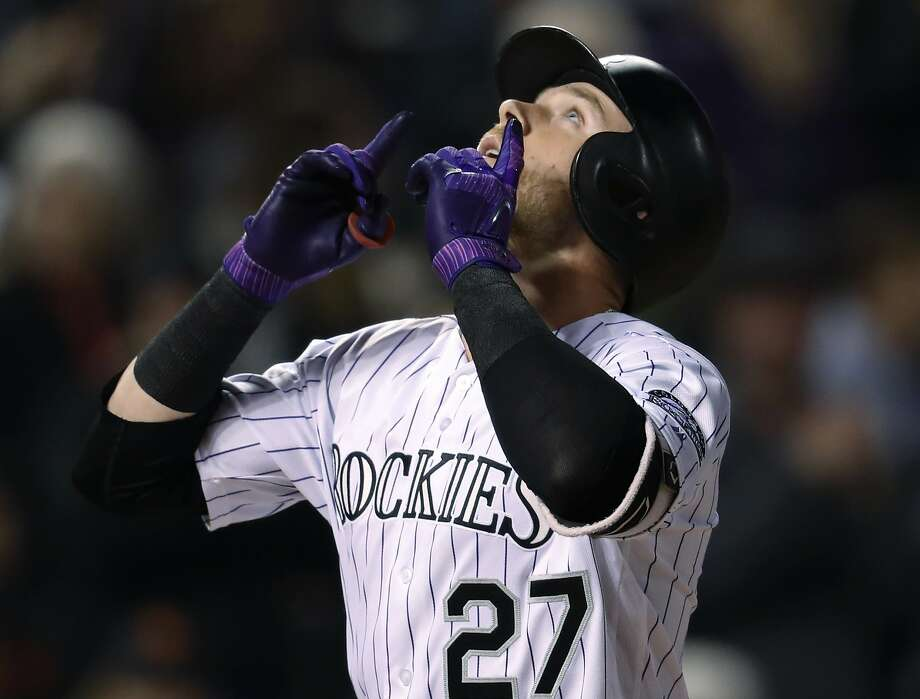 Trevor Story is not asking the airline pilot at 33,000 feet to return his fouth-inning home run ball, but merely gesturing skyward after his 505-foot blast against Andrew Suarez. Photo: David Zalubowski / Associated Press
