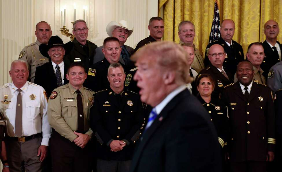 Sheriffs, including Rensselaer County's Patrick Russo, top row, right, listens as President Donald Trump responds to a reporter's question during an event in the East Room of the White House in Washington, Wednesday, Sept. 5, 2018.