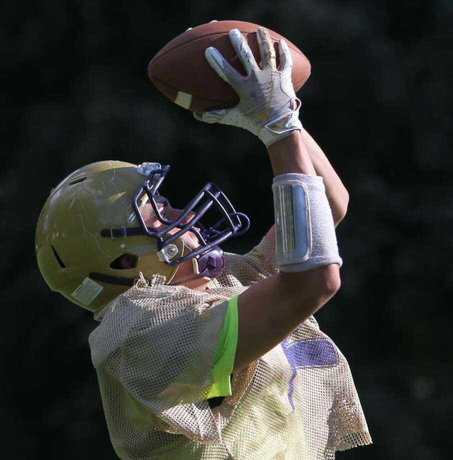 Routt's Lincoln Lahey makes a catch during warmups for practice on Monday. Routt (2-0) hosts Camp Point Central (2-0) this Friday night. Photo: Dennis Mathes | Journal-Courier