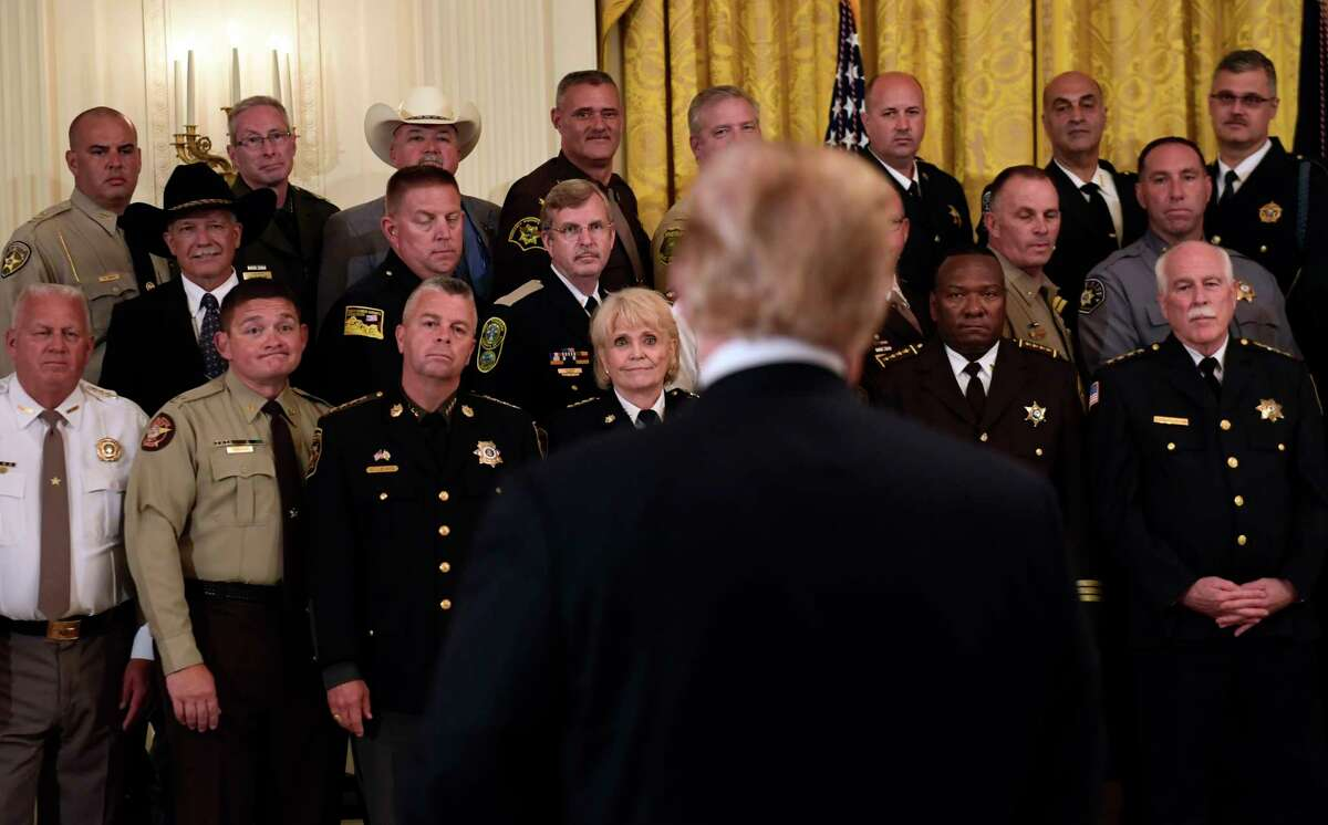 Sheriffs, including Rensselaer County's Patrick Russo, top row, second from right, listens as President Donald Trump responds to a reporter's question during an event in the East Room of the White House in Washington, Wednesday, Sept. 5, 2018.
