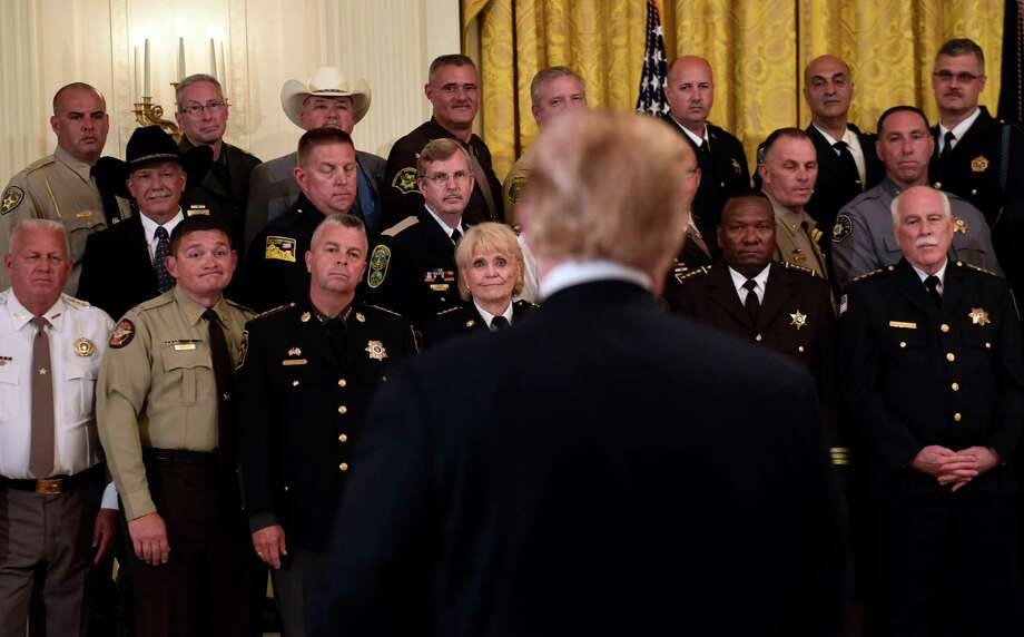 Sheriffs, including Rensselaer County's Patrick Russo, top row, second from right, listens as President Donald Trump responds to a reporter's question during an event in the East Room of the White House in Washington, Wednesday, Sept. 5, 2018. Photo: Susan Walsh, AP / Copyright 2018 The Associated Press. All rights reserved.