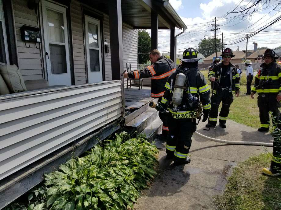 "Danbury firefighters at the scene of a porch fire near Wildman and Austin streets on Wednesday, Sept. 5, 2018. ""Upon arrival units found a small fire on the steps of the porch being extinguished by a good Samaritan. Fortunately the damage was minimal,"" the department posted on Facebook. Photo: /"
