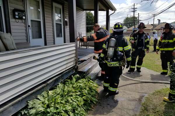 """Danbury firefighters at the scene of a porch fire near Wildman and Austin streets on Wednesday, Sept. 5, 2018. """"Upon arrival units found a small fire on the steps of the porch being extinguished by a good Samaritan. Fortunately the damage was minimal,"""" the department posted on Facebook."""