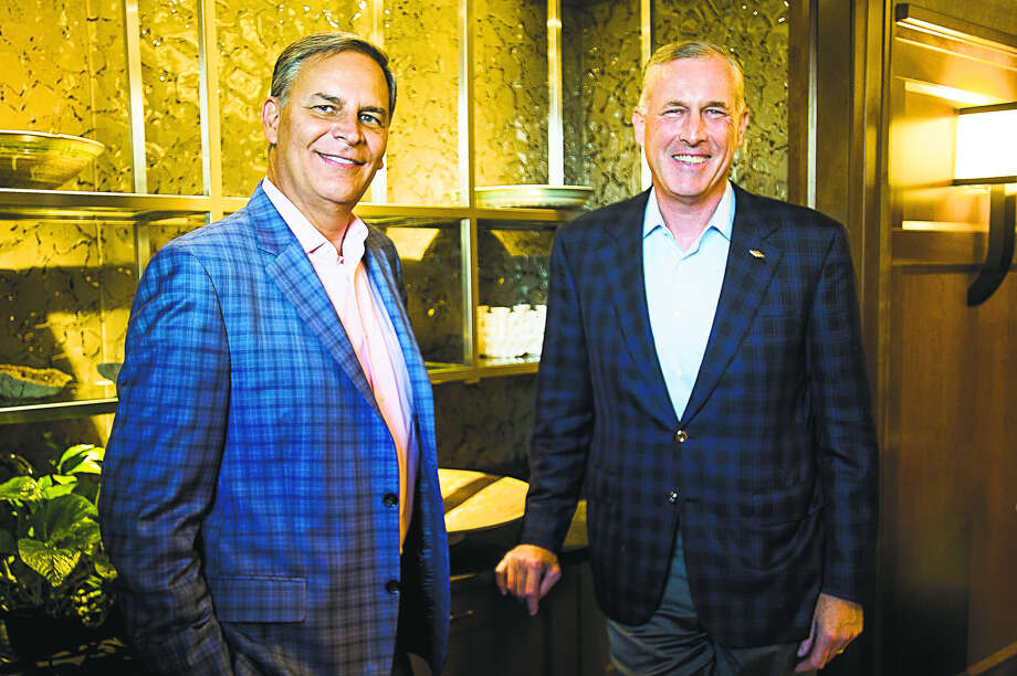 Dow CEO-elect Jim Fitterling, right, and President and CEO of the National Association of Manufacturers Jay Timmons, left, pose for a portrait on Tuesday at the Midland Country Club. (Katy Kildee/kkildee@mdn.net) Photo: Katy Kildee/kkildee@mdn.net
