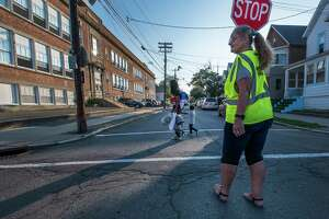 Crossing Guard Paul Greenwood assists arriving students in navigating the streets near the school on opening day at the Hamilton Elementary School Sept. 6, 2018  in Schenectady, N.Y.  (Skip Dickstein/Times Union)