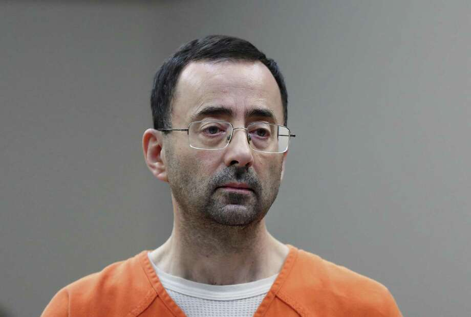 FILE - In this Nov. 22, 2017, file photo, Dr. Larry Nassar appears in court for a plea hearing in Lansing, Mich. Authorities say disgraced former sports doctor Larry Nassar has been transferred to another federal prison facility. The Federal Bureau of Prisons website on Sunday, Aug. 19, 2018, shows the former Michigan State University and USA Gymnastics doctor is at the Oklahoma Federal Transfer Facility. He had been imprisoned in Tucson, Arizona. (AP Photo/Paul Sancya, File) Photo: Paul Sancya, STF / Associated Press / Copyright 2017 The Associated Press. All rights reserved.