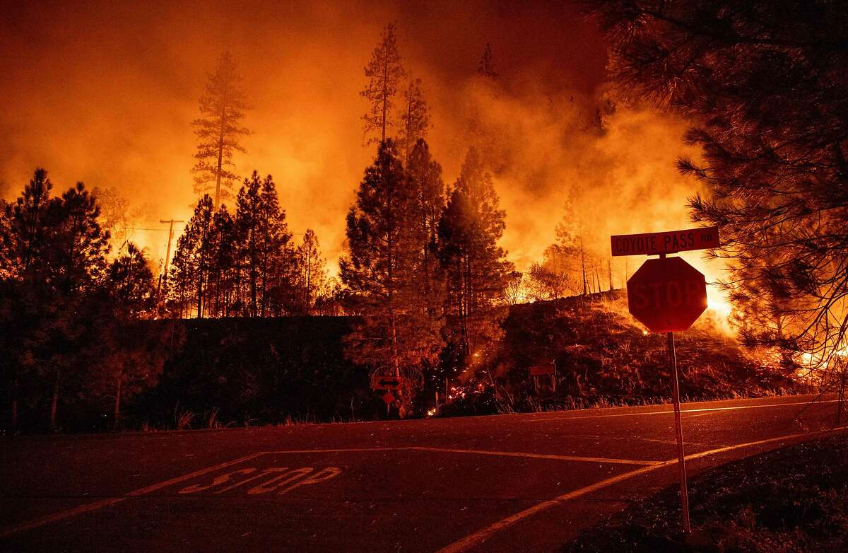 Fire surrounds an intersection during the Delta Fire in near Delta, California on September 6, 2018. (Photo by JOSH EDELSON / AFP)JOSH EDELSON/AFP/Getty Images