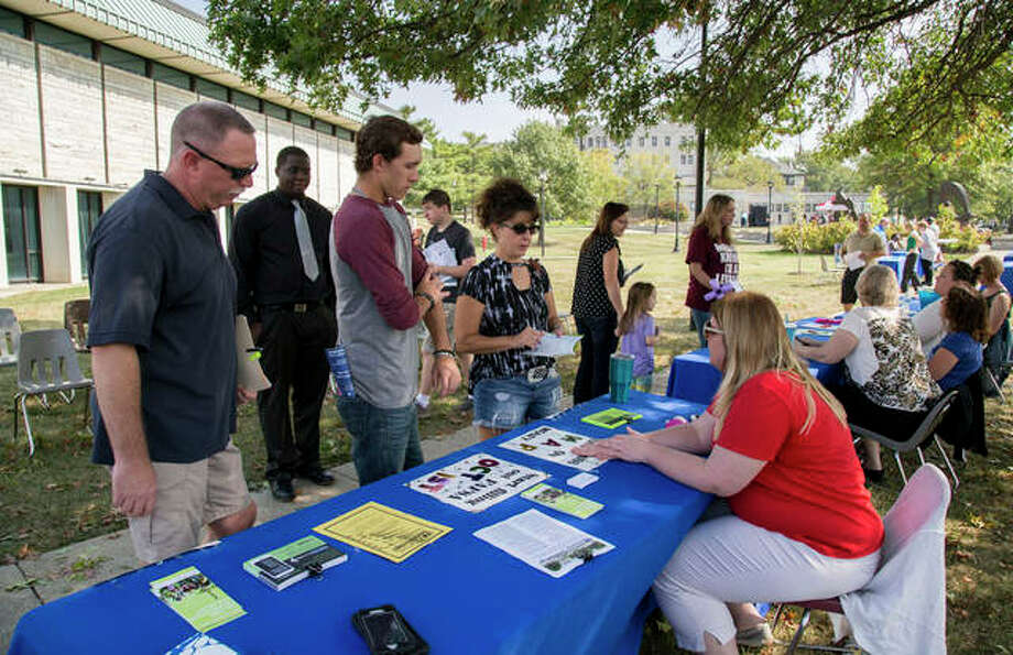 Students and their families discuss financial aid options with L&C staff during Lewis and Clark Community College's Fall 2017 Discover Day event. Photo: Photo Courtesy Of Lewis And Clark Community College