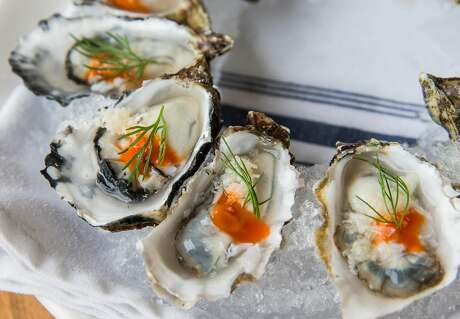 A ring of oysters at Pearl. Photo: Jessica Christian / The Chronicle