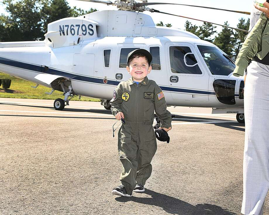 "Sikorsky, a Lockheed Martin company, partnered with Make-A-Wish to give six-year-old William Beyer and his family a ""Pilot for a Day"" experience on Sept. 5, 2018 in Stratford. William was born with a rare heart defect called Hypoplastic Right Heart Syndrome. At 10 months of age, he underwent a heart transplant and continues to work with doctors to prevent organ rejection. Photo: Sikorsky /Lockheed Martin Photo"