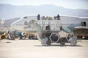 "Participants attend Burning Man 2018, the largest outdoor arts festival    in North America, in the Black Rock Desert of Gerlach, Nev.  (""Sidney Erthal works with the Burning Man Project as an archivist, photographer, and translator."")"