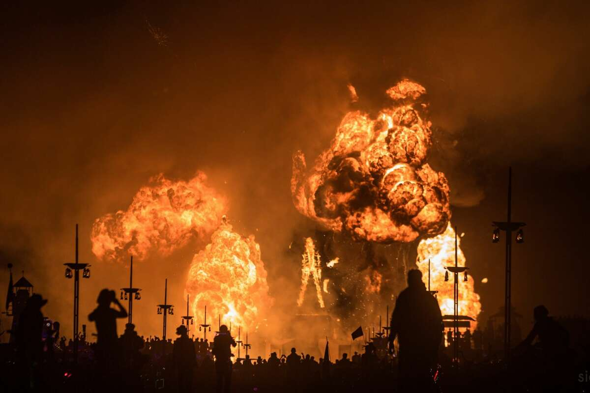Participants watch the Burning of the Man which marks the end of Burning Man 2018, the largest outdoor arts festival in North America, in the Black Rock Desert of Gerlach, Nevada. (