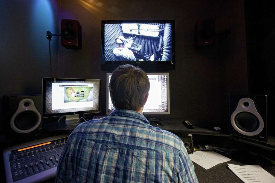Newsfix sound designer Craig Anderson, monitors Newsfix narrator Grego Onofrio as he records a news spot. NEXT: See anchors and TV reporters that are changing jobs or stations. Photo: TODD SPOTH, Photographer / For The Chronicle / Freelance
