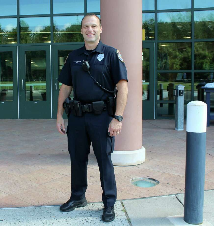 Westport's new school resource officer, Ed Wooldridge, poses outside Staples High School on Sept. 5. Photo: Sophie Vaughan / Hearst Connecticut Media / Westport News
