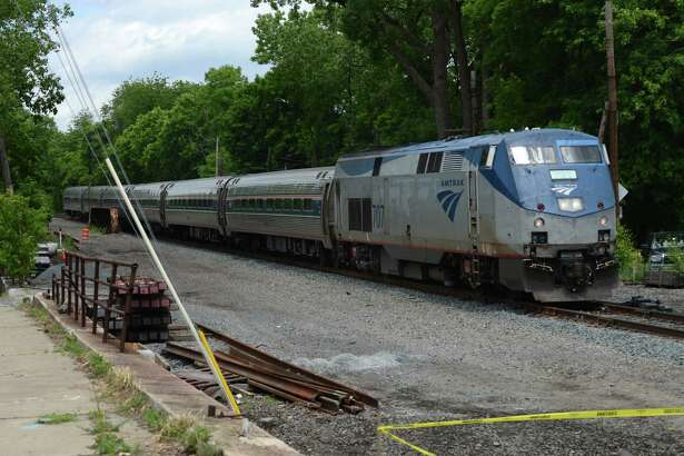 An Amtrak passenger train from Schenectady heads down the line near Broadway and North Pearl Street where work has begun on adding a second track on Monday, June 6, 2016, in Albany, N.Y. The second track between Albany and Schenectady will remove a bottleneck on Amtrak?•s Empire Corridor connecting New York City and Buffalo. (Will Waldron/Times Union)