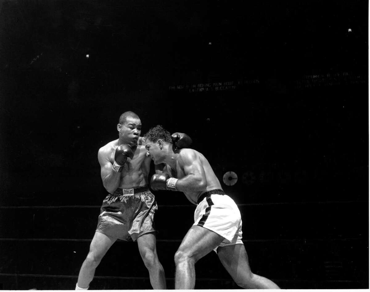 Joe Louis, left, former heavyweight champion, and Rocky Marciano are shown during the 3rd round of their bout at Madison Square Garden in New York City on Oct. 26, 1951. Marciano won by TKO in 2:36 of 8th round.