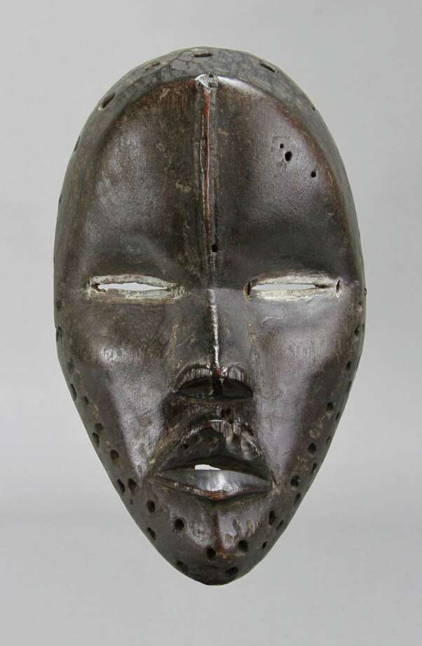 "This Deangle mask of the Dan, or Gio, people of Liberia will be among the pieces on display in ""Liberia, 1931-33: The Collections of Alfred J. Tulk,"" a show opening September 14, 2018, at the Fairfield University Art Museum. The show teams objects collected by the late artist during a visit to the African nation during the early 1930s, as well as his artwork. A longtime Fairfield and New Haven counties resident, Tulk died in 1988. Private collection. FIG 1: Mask (Deangle). Dan/Gio, Liberia. Wood, kaolin. 8 inches. Private collection. Photo: Private Collection / Contributed Photo / Connecticut Post contributed"