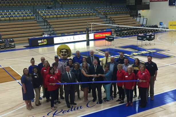 Wayland Baptist University and the Plainview Chamber of Commerce officially cut the ribbon celebrating the new floor at Hutcherson Gymnasium Tuesday evening prior to the Wayland Pioneers volleyball match against Oklahoma Panhandle State University.