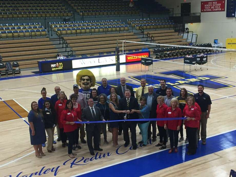 Wayland Baptist University and the Plainview Chamber of Commerce officially cut the ribbon celebrating the new floor at Hutcherson Gymnasium Tuesday evening prior to the Wayland Pioneers volleyball match against Oklahoma Panhandle State University. Photo: Roijon Johnson/Plainview Herald