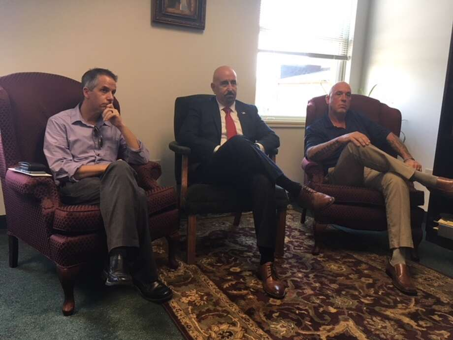 From left, Michael Arpey, Gerard Amedio and Robert Georgia talk about the treatment crime victims receive from District Attorney Karen Heggen's office. Amedio is facing Heggen in a Republican primary for Saratoga County's top lawyer. Photo: Wendy Liberatore/Times Union