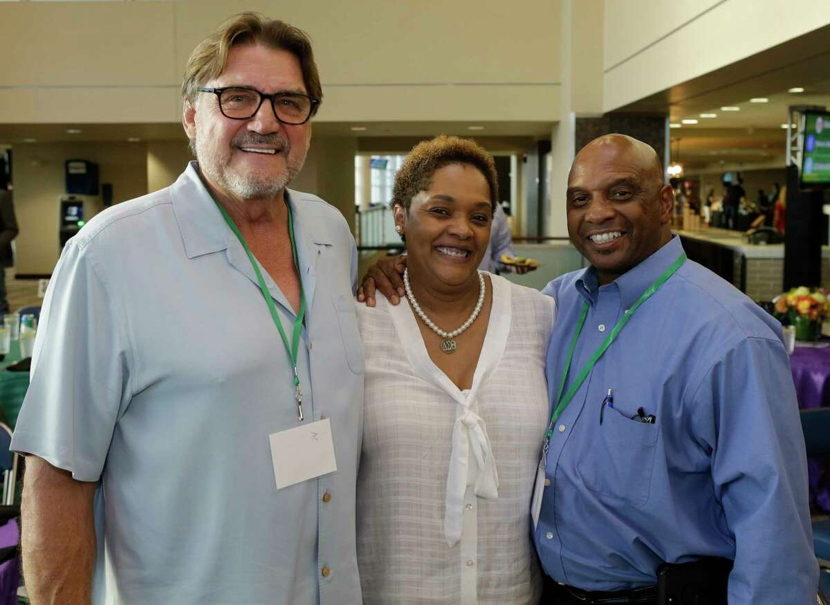 Dan Pastorini, left, Paula McNeil, and Gerald McNeil, right, are shown during the 5th Annual Fantasy Football Draft Night benefiting Today's Harbor for Children at NRG Stadium Wednesday, Sept. 5, 2018, in Houston.