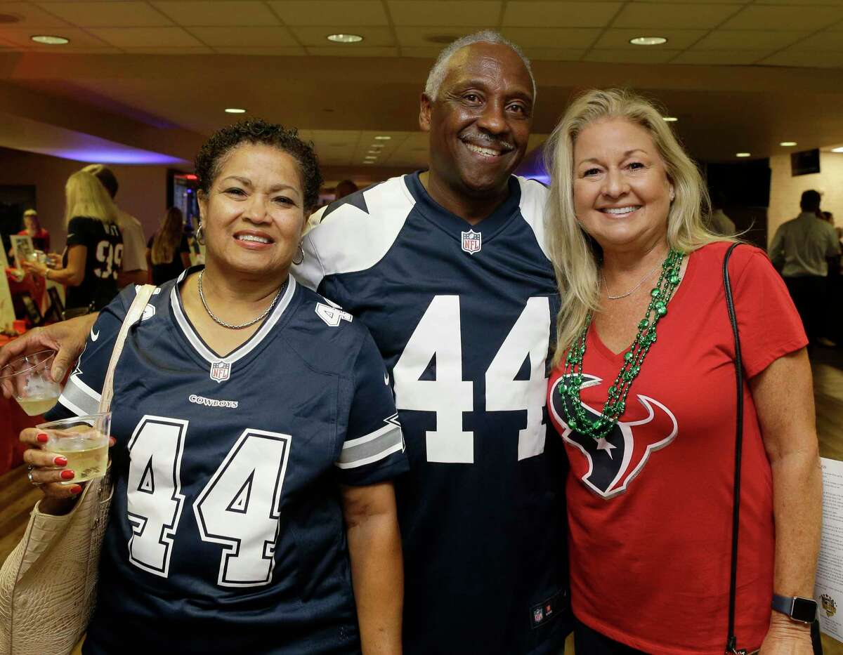 Rhonda Newhouse, left, Fred Newhouse, and Paige Knudsen, right, are shown during the 5th Annual Fantasy Football Draft Night benefiting Today's Harbor for Children at NRG Stadium Wednesday, Sept. 5, 2018, in Houston.
