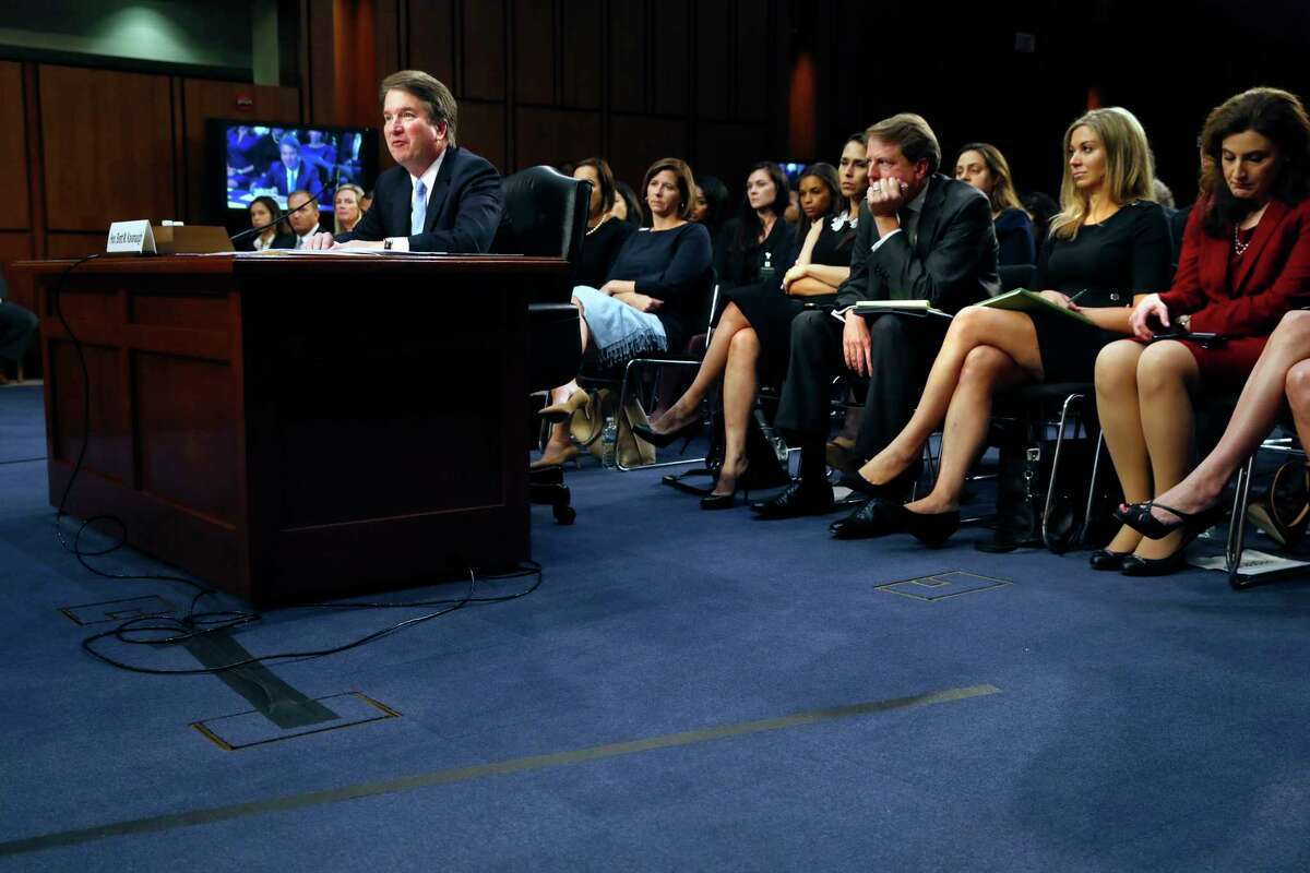 As White House counsel Don McGahn, third from right, listens, President Donald Trump's Supreme Court nominee, Brett Kavanaugh, at left, testifies on the third day of his Senate Judiciary Committee confirmation hearing, Thursday, Sept. 6, 2018, on Capitol Hill in Washington, to replace retired Justice Anthony Kennedy.