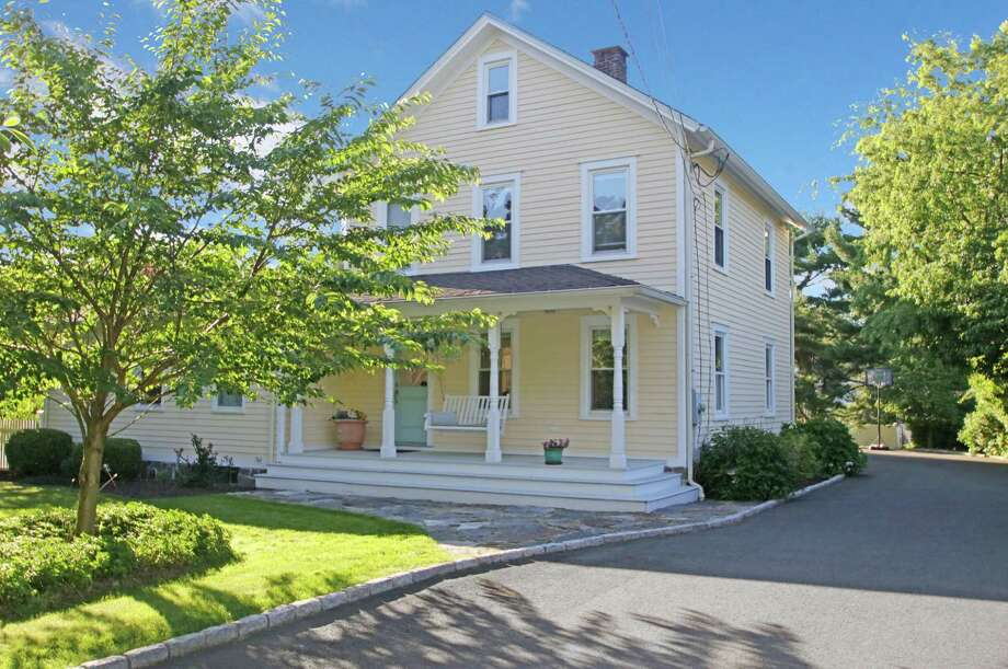 The updated antique colonial farmhouse at 41 Old Road sits on a half-acre corner lot. Photo: Contributed Photos