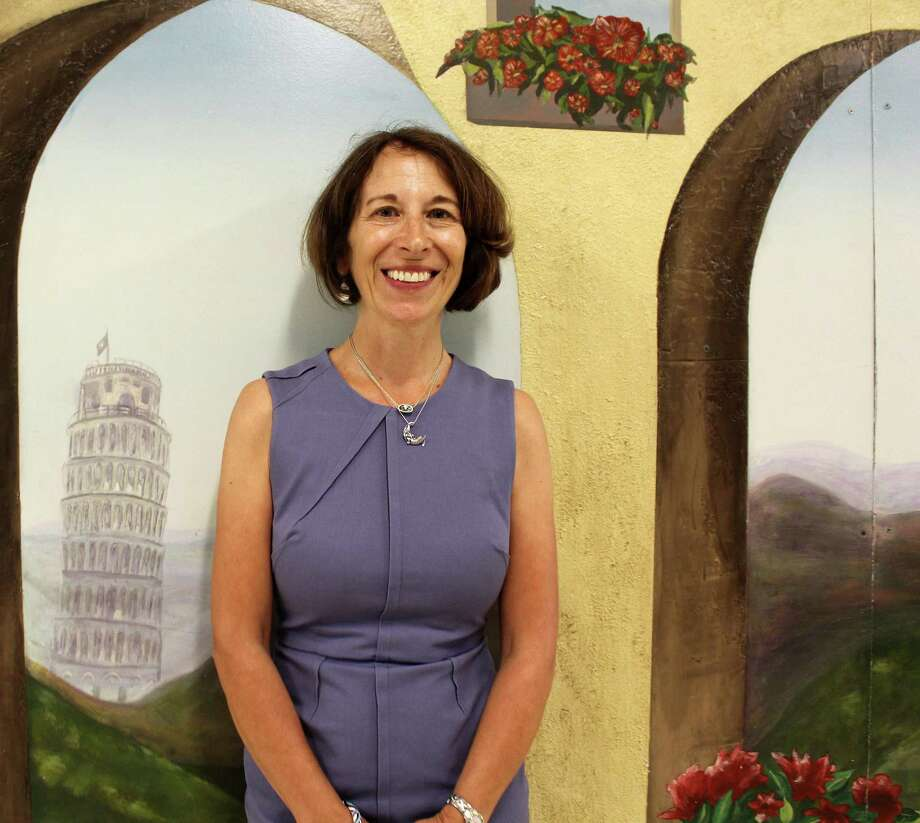 Staples High School Italian teacher Enia Noonan, in front of a mural at the high school, has been named 2018 Westport teacher of the year. Photo: Sophie Vaughan / Hearst Connecticut Media / Westport News