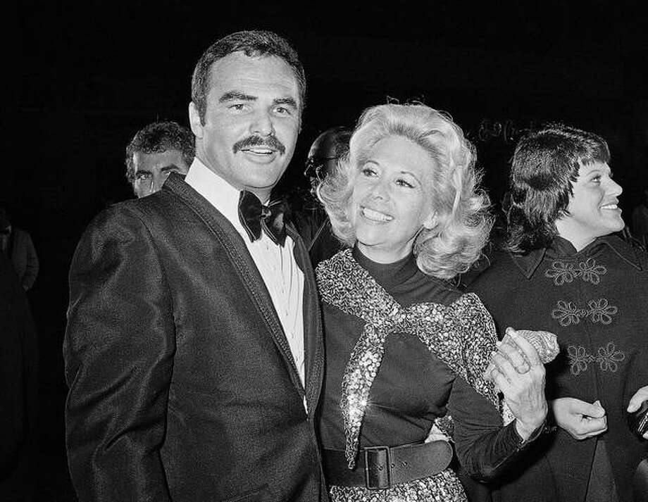 "In this Nov. 5, 1971 file photo, actress Dinah Shore and Burt Reynolds appear together in Los Angeles. Reynolds, who starred in films including ""Deliverance,"" ""Boogie Nights,"" and the ""Smokey and the Bandit"" films, died at age 82, according to his agent. Photo: Associated Press"