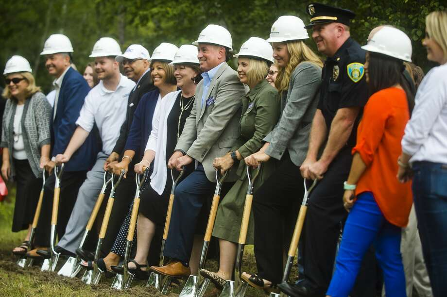 Shelterhouse staff, board members and donors pose for a photo during a groundbreaking ceremony for their future 20,000-square-foot client services center on Thursday, Sept. 6, 2018 at 2500 Waldo Ave. (Katy Kildee/kkildee@mdn.net) Photo: (Katy Kildee/kkildee@mdn.net)