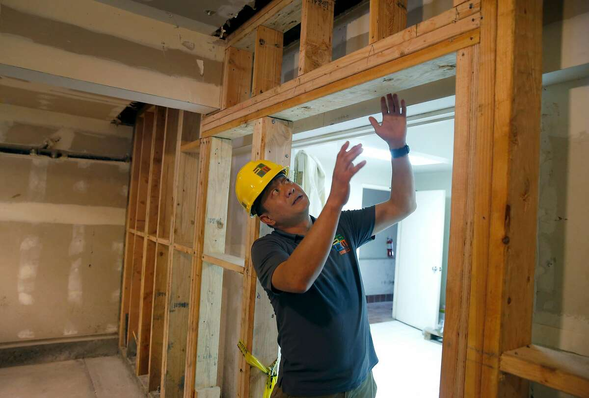 Contractor George Mak describes the work underway for a seismic retrofitting project at a six-unit apartment building in San Francisco, Calif. on Thursday, Sept. 6, 2018. Owners of soft story buildings in the city have until Sept. 15 to file permits for earthquake retrofitting projects.