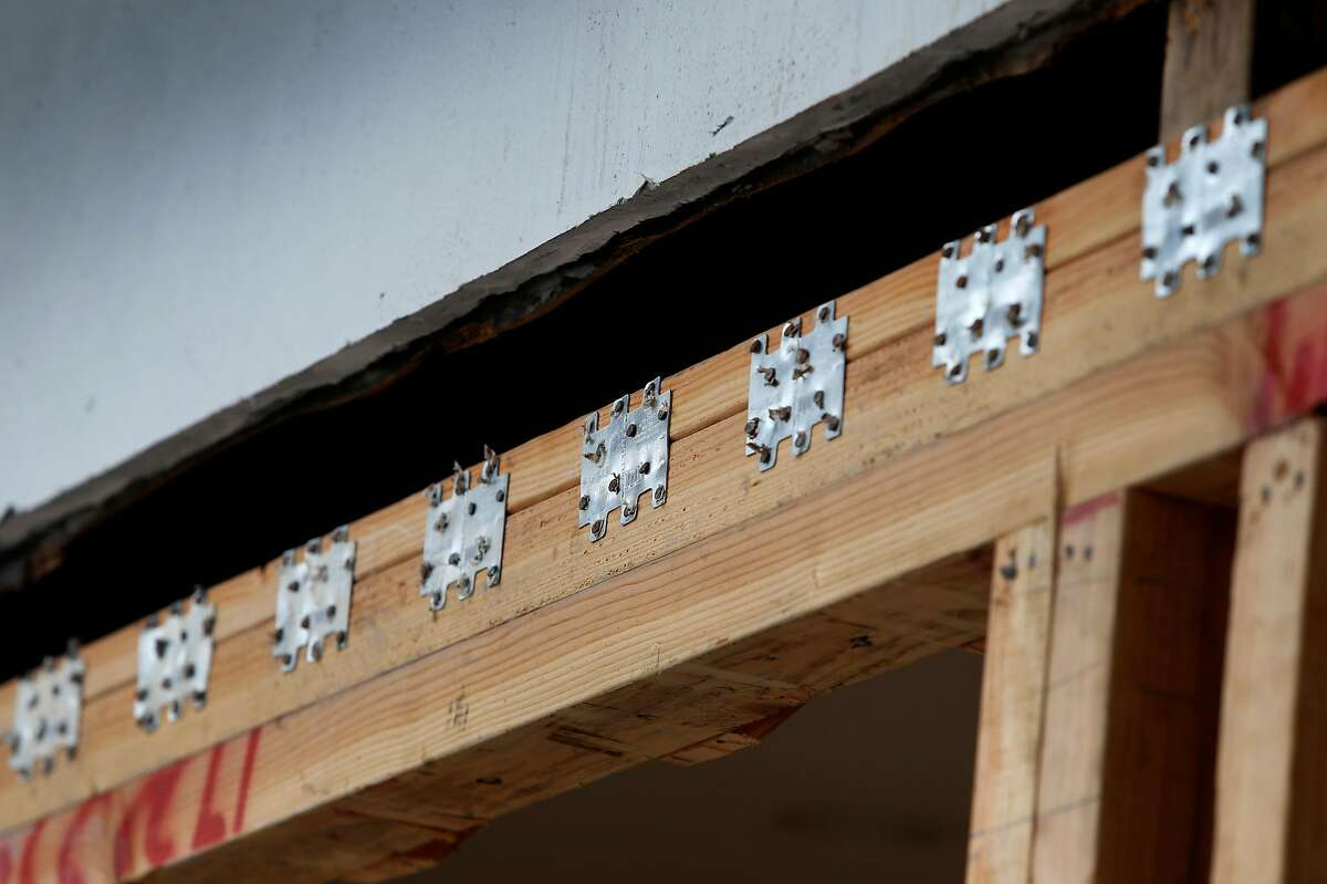 Steel brackets are anchored to wood surfaces in an earthquake retrofitting project at a six-unit apartment building in San Francisco, Calif. on Thursday, Sept. 6, 2018. Owners of soft story buildings in the city have until Sept. 15 to file permits for earthquake retrofitting projects.