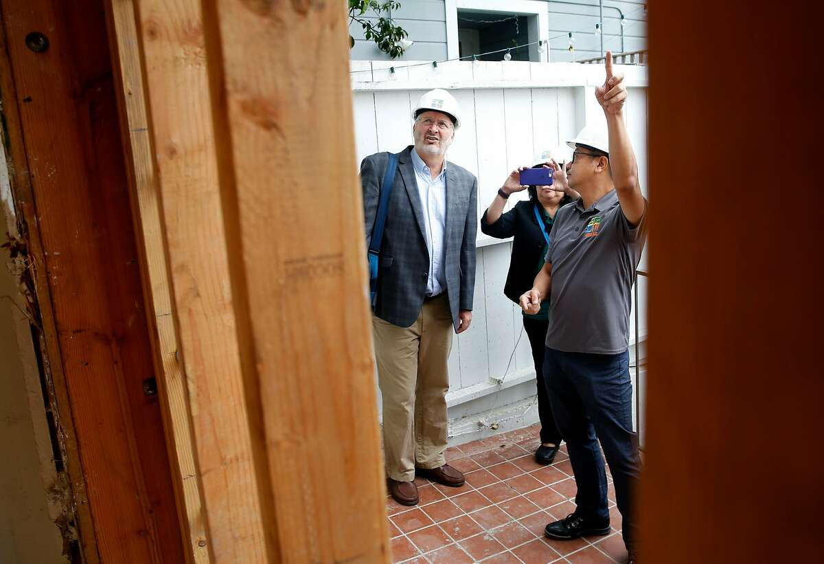 Keith Knudsen (left), deputy director of the USGS Earthquake Science Center, visits a seismic retrofitting project underway at a six-unit apartment building with senior project manager Henry Mak in San Francisco, Calif. on Thursday, Sept. 6, 2018. Owners of soft story buildings in the city have until Sept. 15 to file permits for earthquake retrofitting projects.
