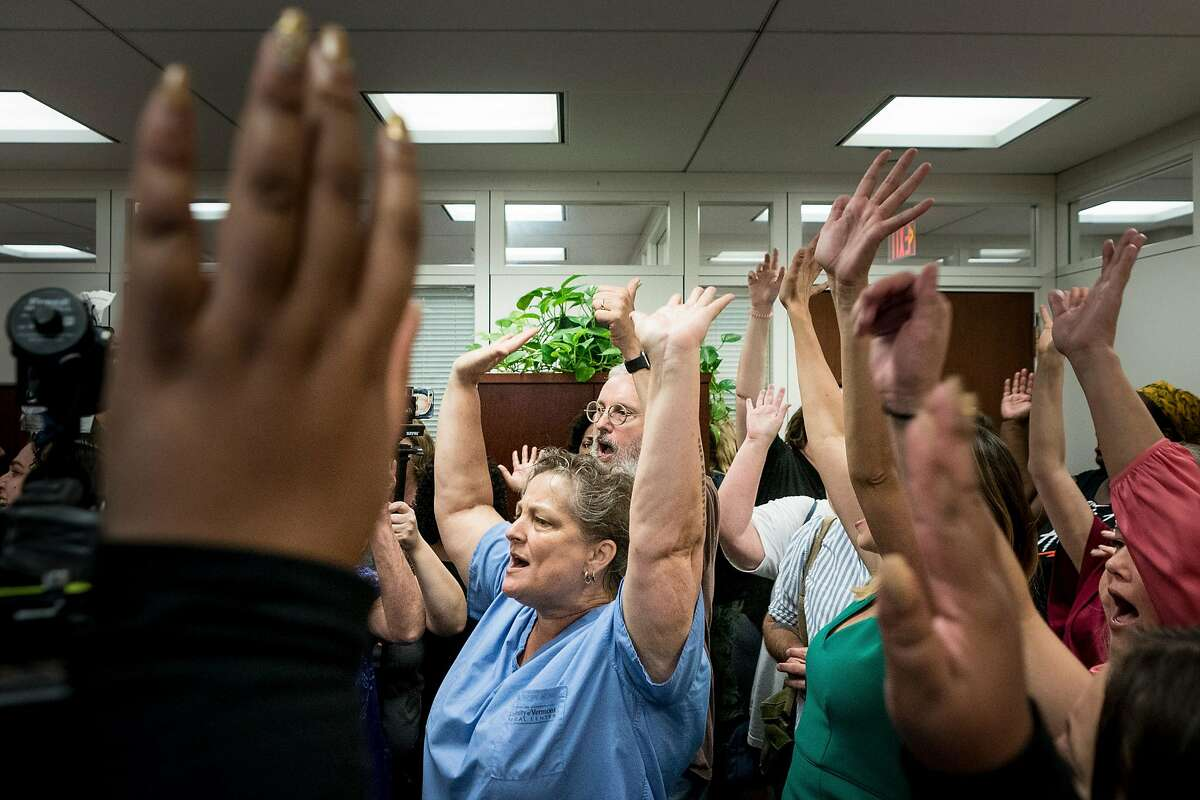 Protesters shout inside Senate Judiciary Committee Chairman Chuck Grassley�s office, before the third day of Judge Brett Kavanaugh's confirmation hearing for the U.S. Supreme Court began on Capitol Hill, in Washington, Sept. 6, 2018. (Erin Schaff/The New York Times)