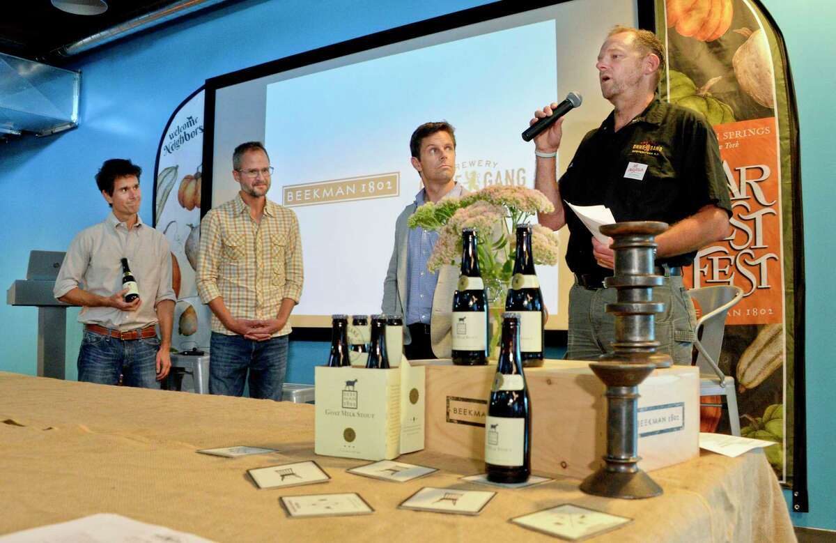 From left, Beekman 1802 founders Brent Ridge, Josh Kilmer-Purcell, Brewery Ommegang president Doug Campbell and brewmaster Phil Leinhart announce their collaboration to brew limited edition Goat Milk Stout Beer during a news conference Wednesday Sept. 5, 2018 in Schenectady, NY. (John Carl D'Annibale/Times Union)