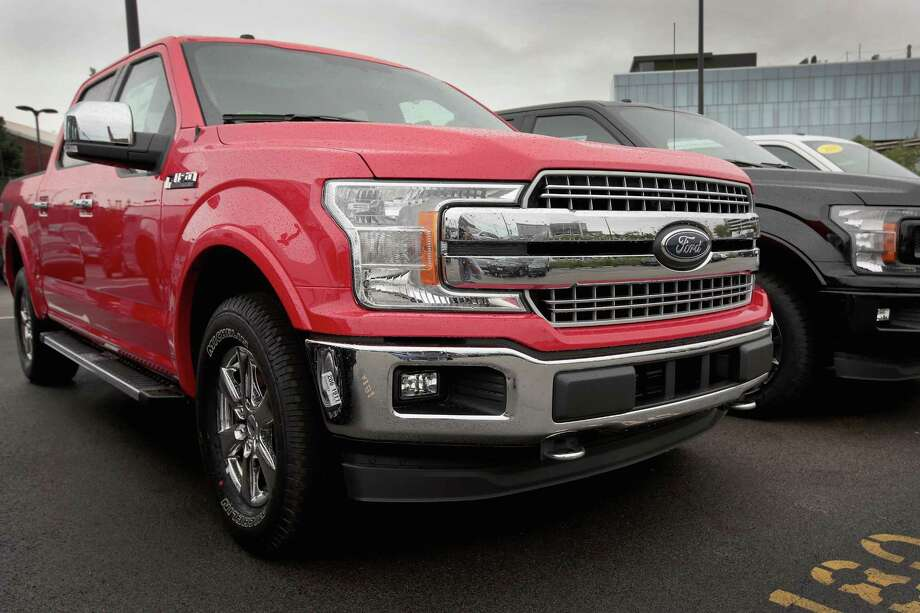 Ford F-150 pickup trucks are offered for sale at a dealership on September 6, 2018 in Chicago, Illinois. Ford has announced a recall of about 2 million of the trucks because of a seatbelt problem that could result in a fire. Photo: Scott Olson /Getty Images / 2018 Getty Images
