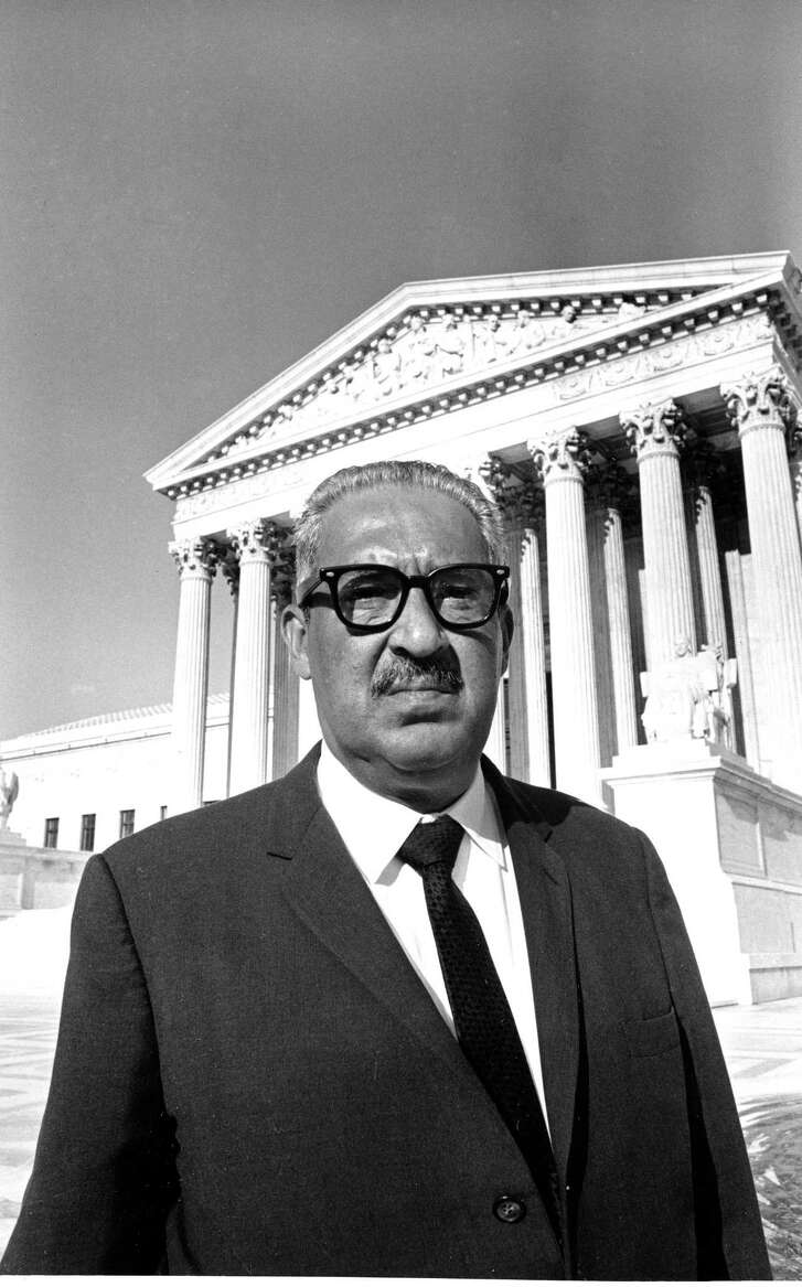 Justice Thurgood Marshall stands outside the Supreme Court Building in Washington, September 1, 1967, after he was sworn in as the first black associate justice to serve on the high court. (AP Photo)