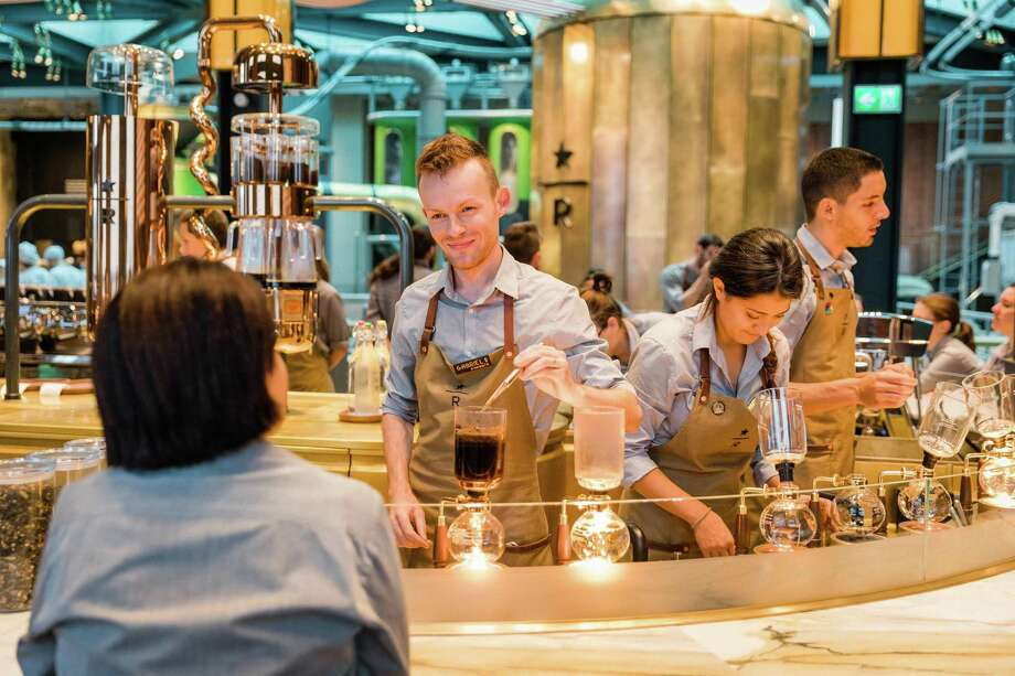 Starbucks barista Gabriel Sebastian Denes works at the siphon brewing station at the Starbucks Reserve Roastery in Milan, Italy on Sunday, Aug. 2, 2018. Photo: Joshua Trujillo /Starbucks /TNS / Seattle Times