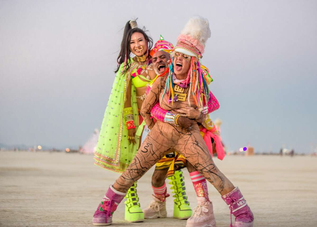 FILE - Participants at Burning Man 2018.