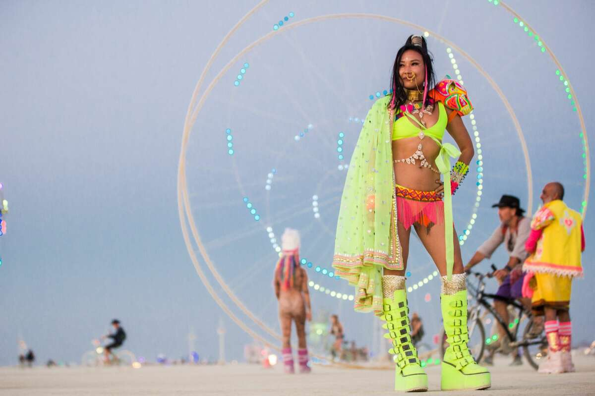 FILE -- Participants at Burning Man 2018. Burning Man organizers are protesting some suggested changes by the Bureau of Land Management, after a draft environmental impact statement made recommendations on how the event should be run.