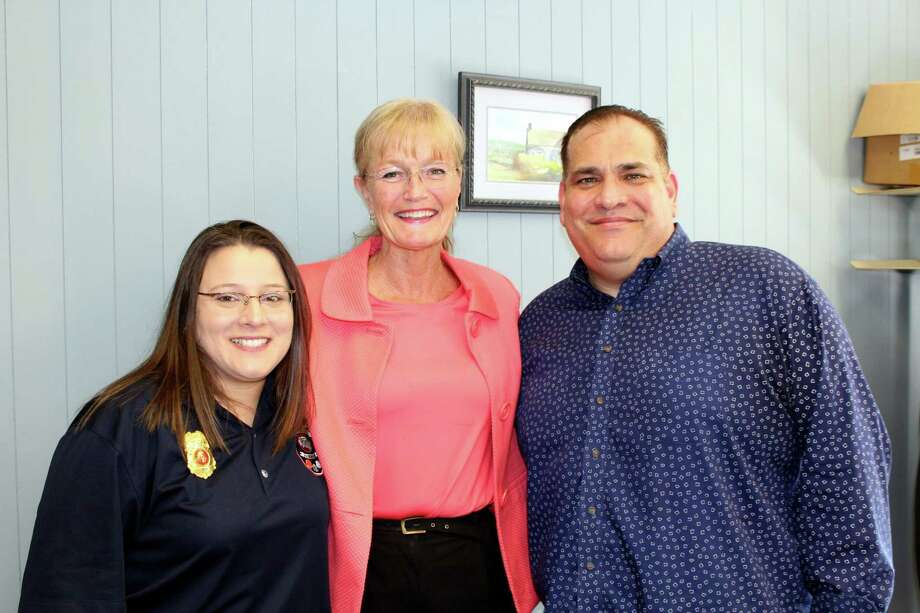 West Haven Mayor Nancy Rossi, center, congratulates 911 dispatcher Jennifer Amendola, left, on her promotion to director of the 911 Communications Center and outgoing Director Abe Colon, right, on his impending retirement. Photo: Contributed / Michael P. Walsh -- City Of West Haven